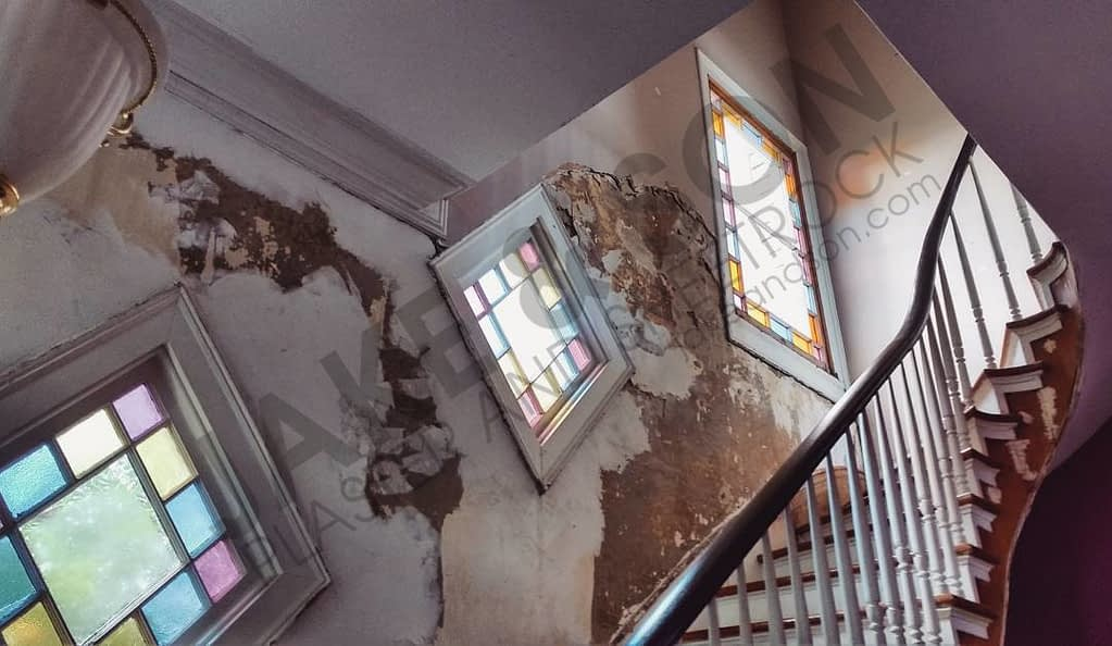 Damaged plastered walls in historic home