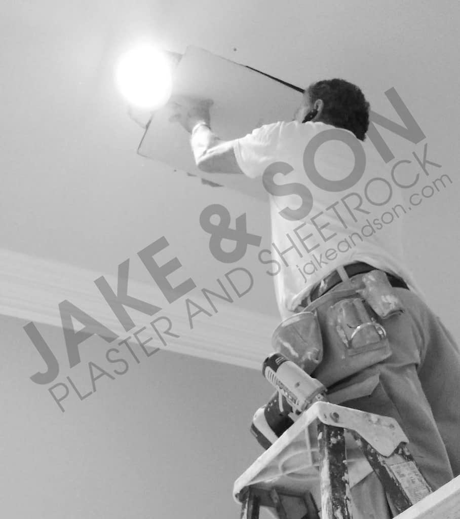 A drywall patch being performed
